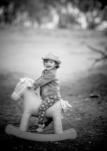 Child with rocking horse © David Hamilton Melby