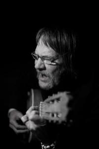 Elder man with guitar © David Hamilton Melby